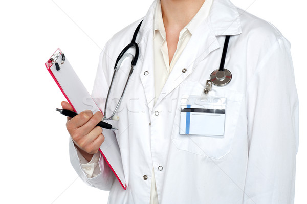 Cropped image of medical expert holding clipboard Stock photo © stockyimages