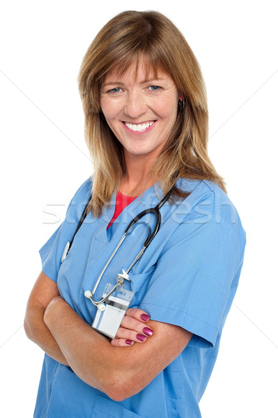 Middle aged female physician with folded arms Stock photo © stockyimages