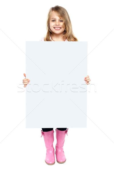 An adorable kid showing blank whiteboard Stock photo © stockyimages