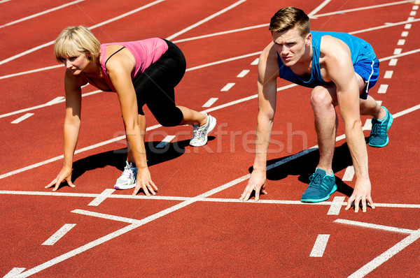 Athletes at starting line on race track Stock photo © stockyimages