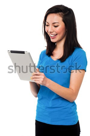 Pretty girl using tablet pc device Stock photo © stockyimages