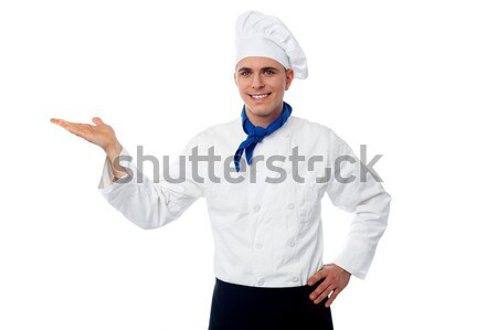 Smiling male chef showing something Stock photo © stockyimages