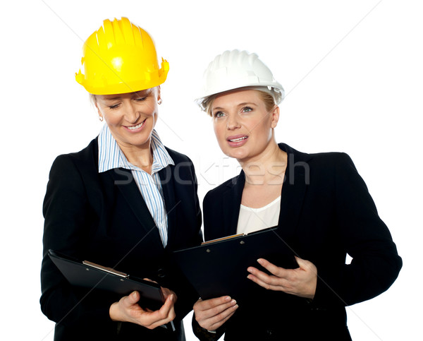 Young female architects reviewing documents Stock photo © stockyimages