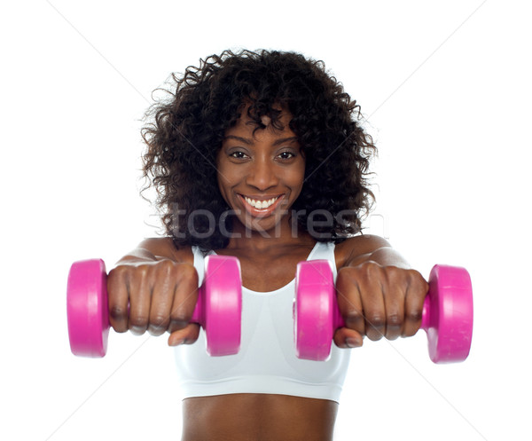 Portrait of curly haired african fit woman Stock photo © stockyimages