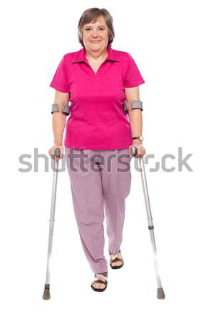 Full length portrait of an injured senior woman Stock photo © stockyimages