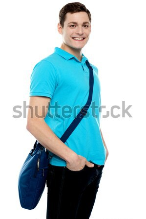Teenage guy carrying laptop bag Stock photo © stockyimages