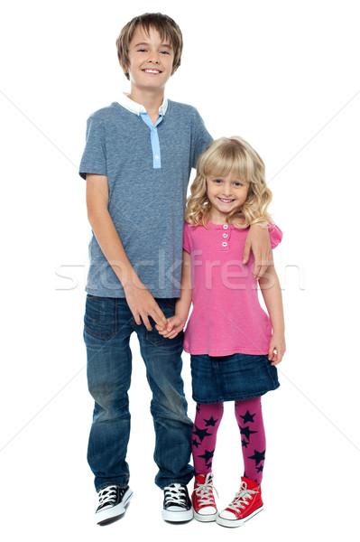 Puce garçon cute soeurs main Photo stock © stockyimages