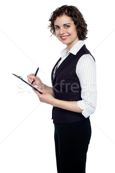 Genç yürütme aşağı önemli notlar güzel Stok fotoğraf © stockyimages