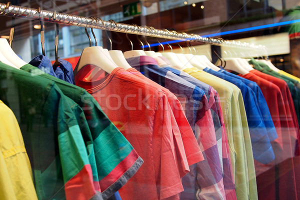 Fashion clothing on hangers at the show Stock photo © stockyimages