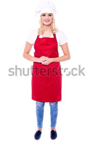 Attractive female chef in red apron and toque Stock photo © stockyimages