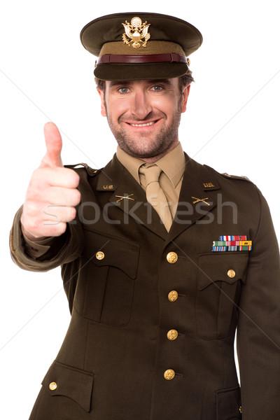 Boldog katonaság férfi gesztikulál remek mosolyog Stock fotó © stockyimages