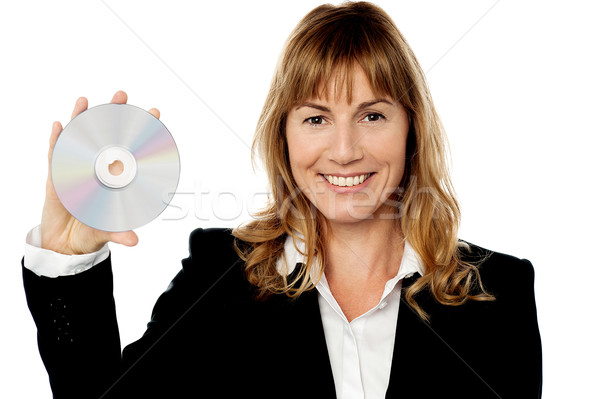 Smiling female manager showing compact disc Stock photo © stockyimages