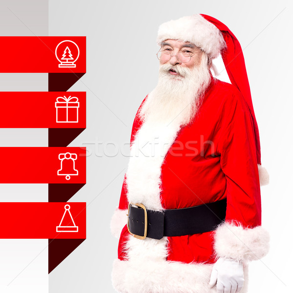 Santa standing with x-mas tags Stock photo © stockyimages