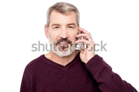 Exciting young handsome man shouting Stock photo © stockyimages