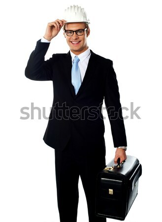 Portrait of smiling young architect carrying briefcase Stock photo © stockyimages