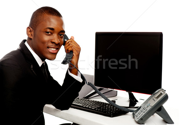 African businessman attending phone call Stock photo © stockyimages