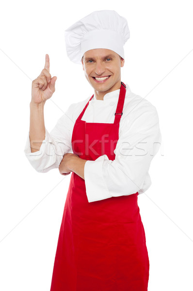 Happy smiling chef showing index finger Stock photo © stockyimages