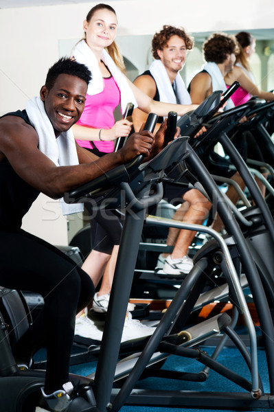 Working out gets easier, if done with friends. Stock photo © stockyimages