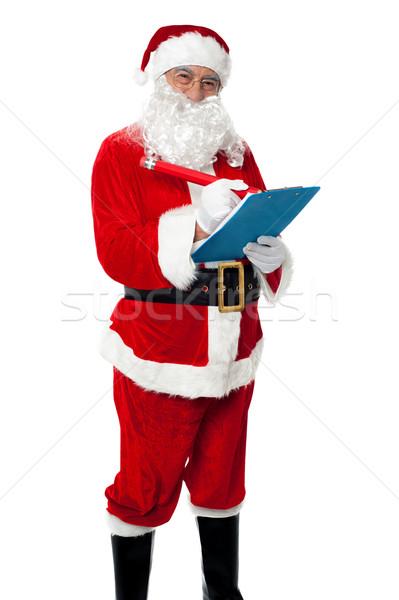 Stockfoto: Kerstman · lijst · geschenk · glimlachend · camera