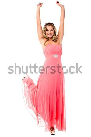 Jubilant young woman rejoicing Stock photo © stockyimages