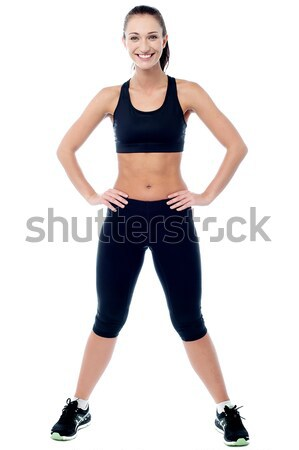 Slim athletic woman posing with a radiant smile Stock photo © stockyimages