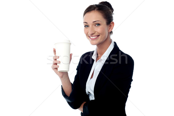 Cheerful business lady holding beverage Stock photo © stockyimages