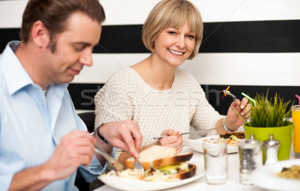 Couple enjoying delicious breakfast Stock photo © stockyimages