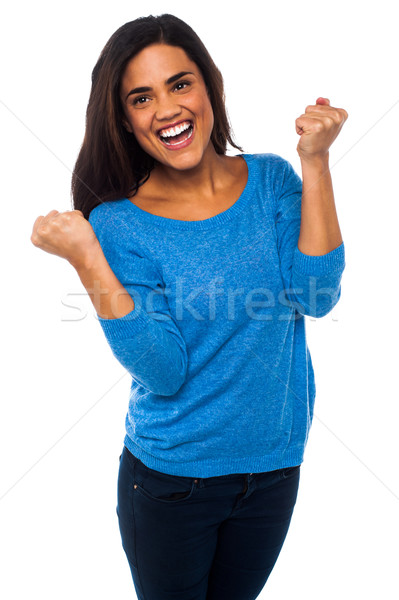 Excited pretty girl with clenched fists Stock photo © stockyimages