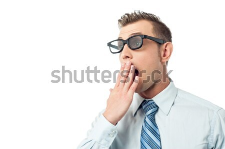 Young businessman, hand on mouth Stock photo © stockyimages