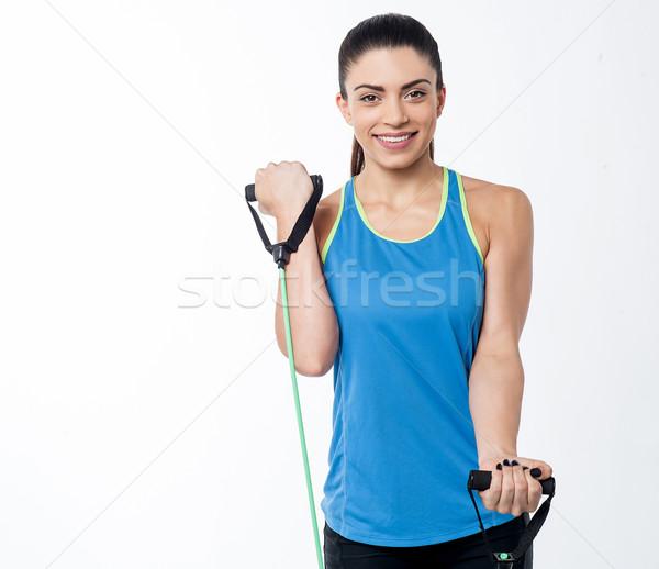 Enyém bicepsz testmozgás nő ellenállás zenekar Stock fotó © stockyimages