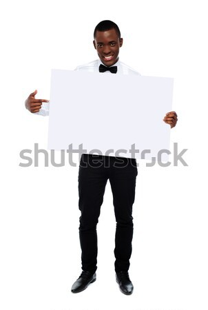 Guy indicating towards blank whiteboard Stock photo © stockyimages