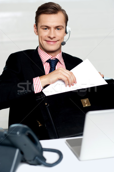 Customer care person arranging office documents Stock photo © stockyimages