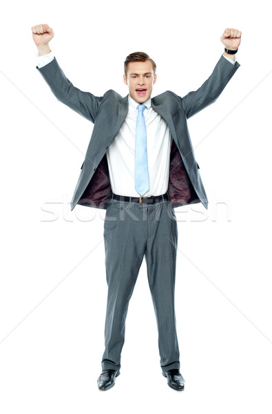 Full length portrait of a excited young executive Stock photo © stockyimages