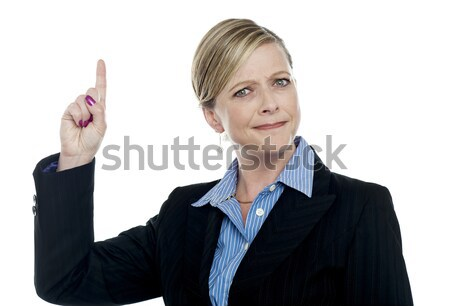 Expressive businesswoman with pointing finger Stock photo © stockyimages