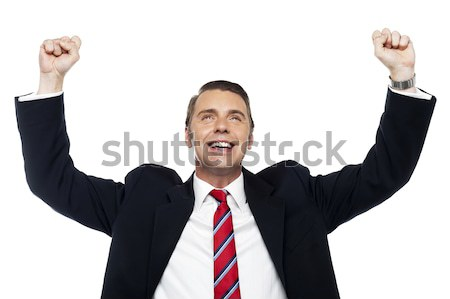 Successful corporate male, arms raised Stock photo © stockyimages