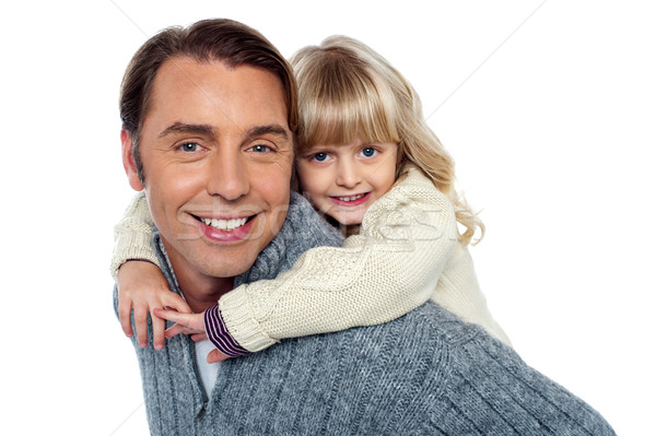 Cute little daughter piggybacking her father Stock photo © stockyimages