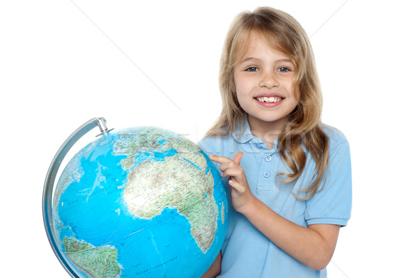 Stock photo: Young girl selecting holiday destination over globe