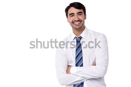 Smiling male executive posing with confidence Stock photo © stockyimages