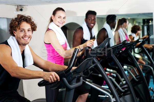 Emberek tornaterem edz boldogan mosolyog fiatalok Stock fotó © stockyimages