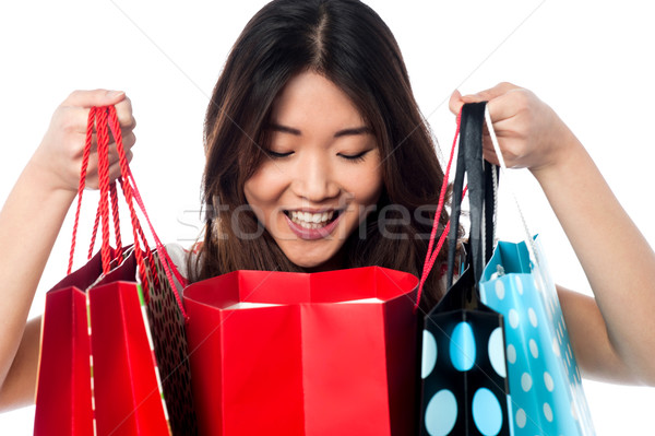 Shopaholic girl holding shopping bags Stock photo © stockyimages