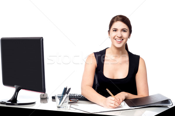 Corporate lady preparing documents Stock photo © stockyimages