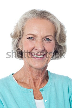 Cheerful portrait of smiling senior woman Stock photo © stockyimages