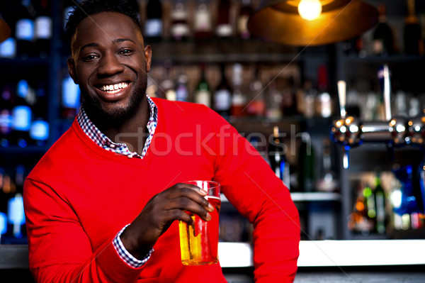 African guy posing with chilled beer Stock photo © stockyimages