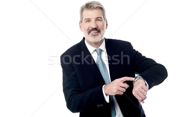 Tijd vergadering zakenman wijzend business Stockfoto © stockyimages