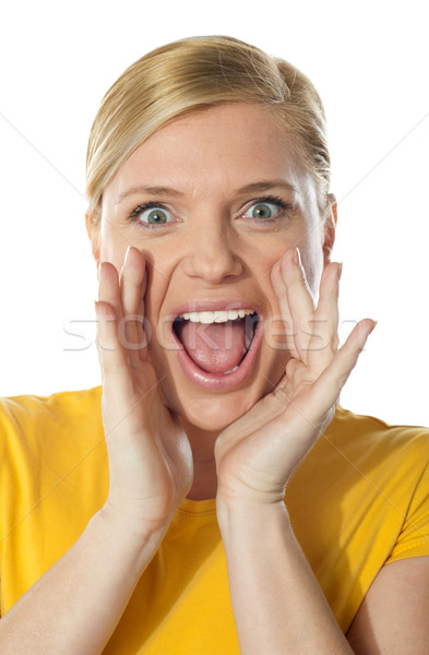 Excited cute girl in front of camera Stock photo © stockyimages