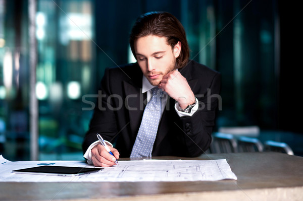 Smart businessman projecting his plans Stock photo © stockyimages