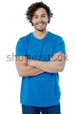 Stylish young  guy posing confidently Stock photo © stockyimages