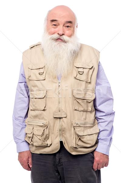 Old man wearing sleeveless jacket Stock photo © stockyimages