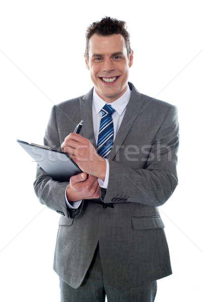 Businessman with clipboard Stock photo © stockyimages