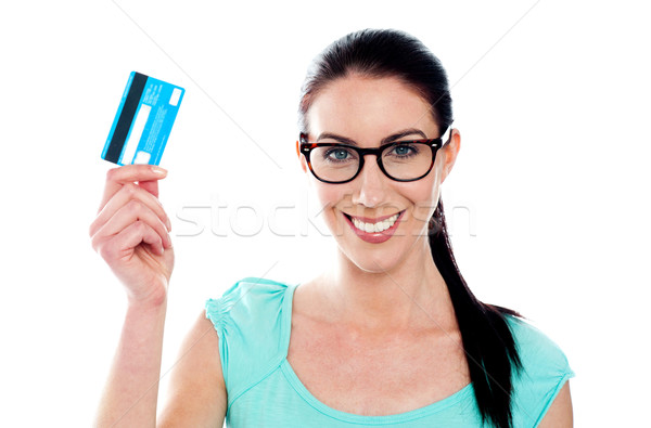 Portrait of young smiling woman holding credit card Stock photo © stockyimages
